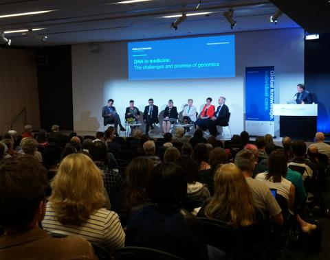 Speakers on stage for the DNA in medicine public forum